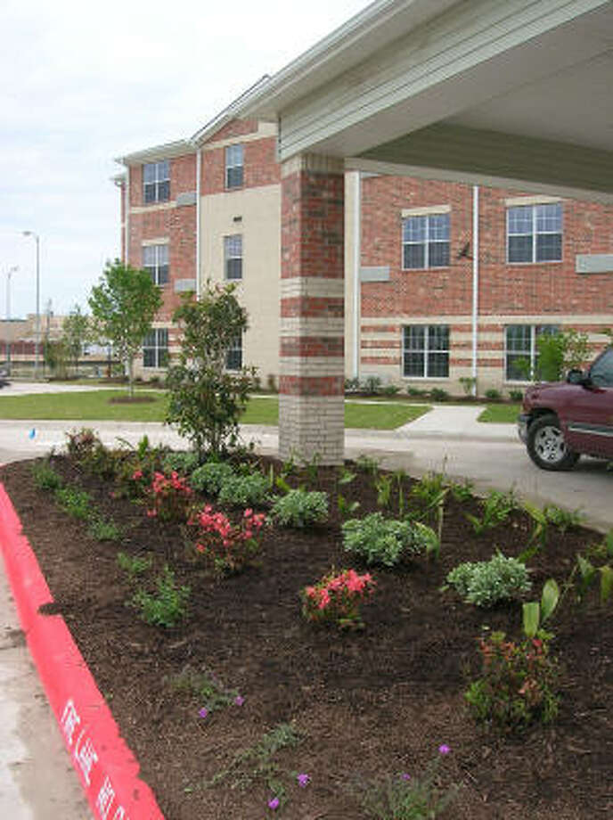 Fresh flowers and plants decorate the main entrance at the new-and-opening soon Bayou Glen Housing (an affordable senior housing community owned and operated by National Church Residences) at 11810 Southglen in the Alief area. Photo date 4-1-09. Photo: L. Scott Hainline, For The Chronicle