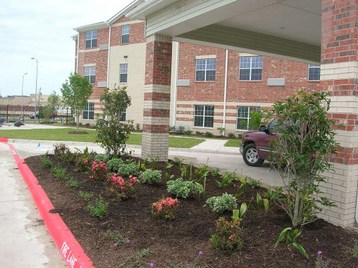 Fresh flowers and plants decorate the main entrance at the new-and-opening soon Bayou Glen Housing (an affordable senior housing community owned and operated by National Church Residences) at 11810 Southglen in the Alief area. Photo date 4-1-09.