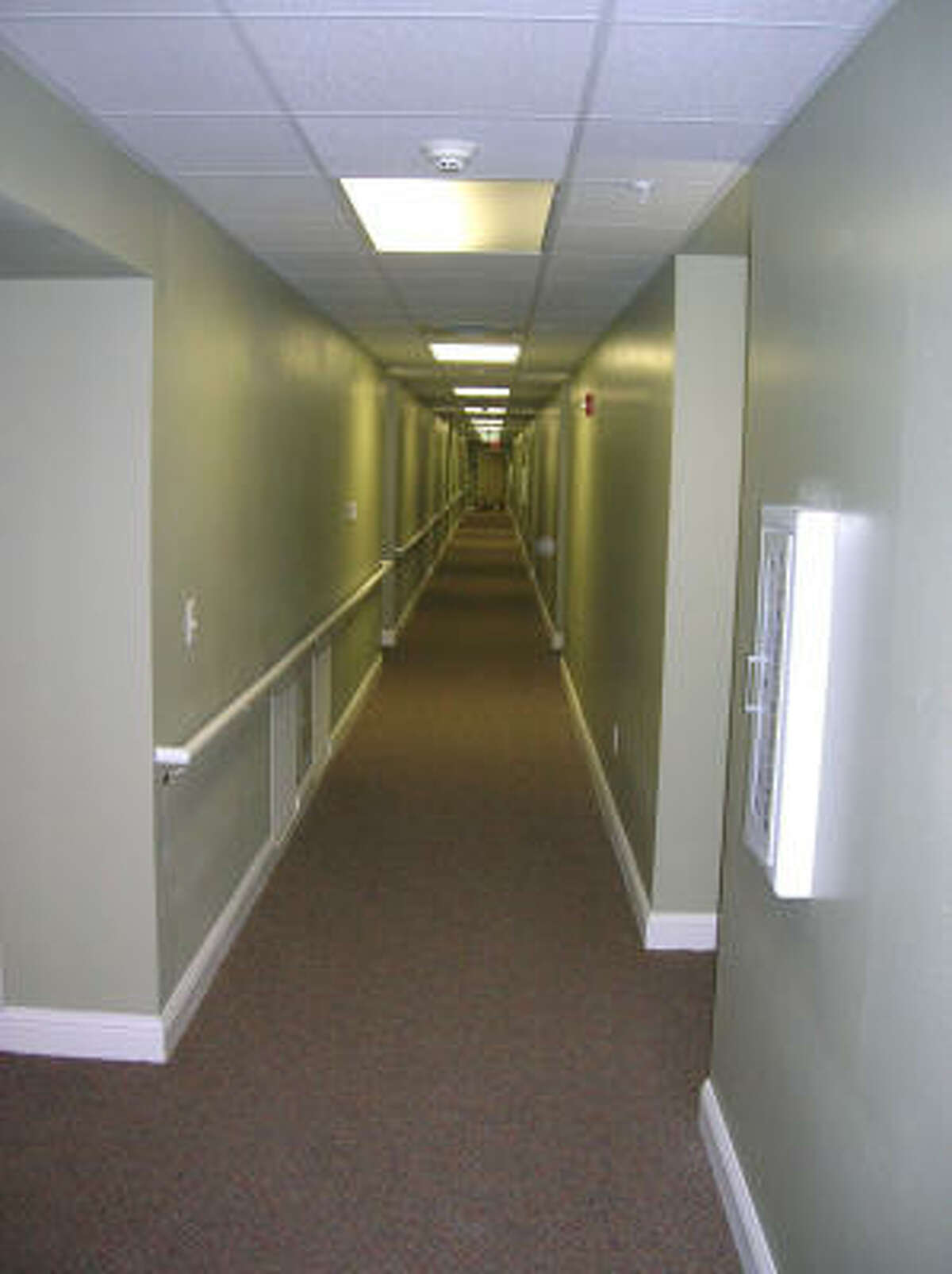 Wide hallways with safety bars are featured on all three floors at the new-and-opening soon Bayou Glen Housing (an affordable senior housing community owned and operated by National Church Residences) at 11810 Southglen in the Alief area. Photo date 4-1-09.