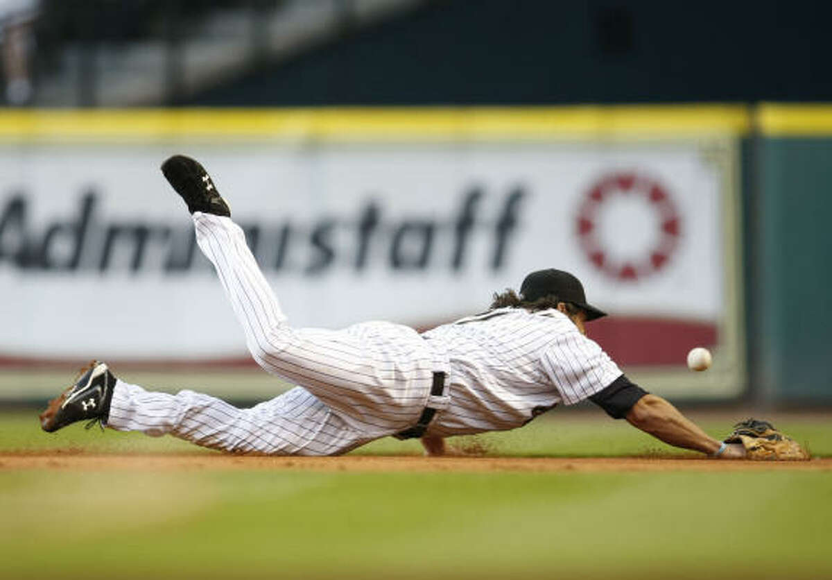 Astros first baseman Lance Berkman is unable to make a diving stop on a ground ball hit by Cubs first baseman Derrek Lee in the first inning.
