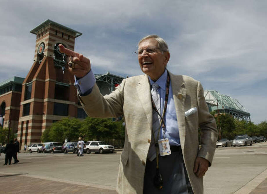 Hamilton, shown at the new Milo Hamilton Way, is now on his 25th season with the Astros. Photo: Julio Cortez, Chronicle