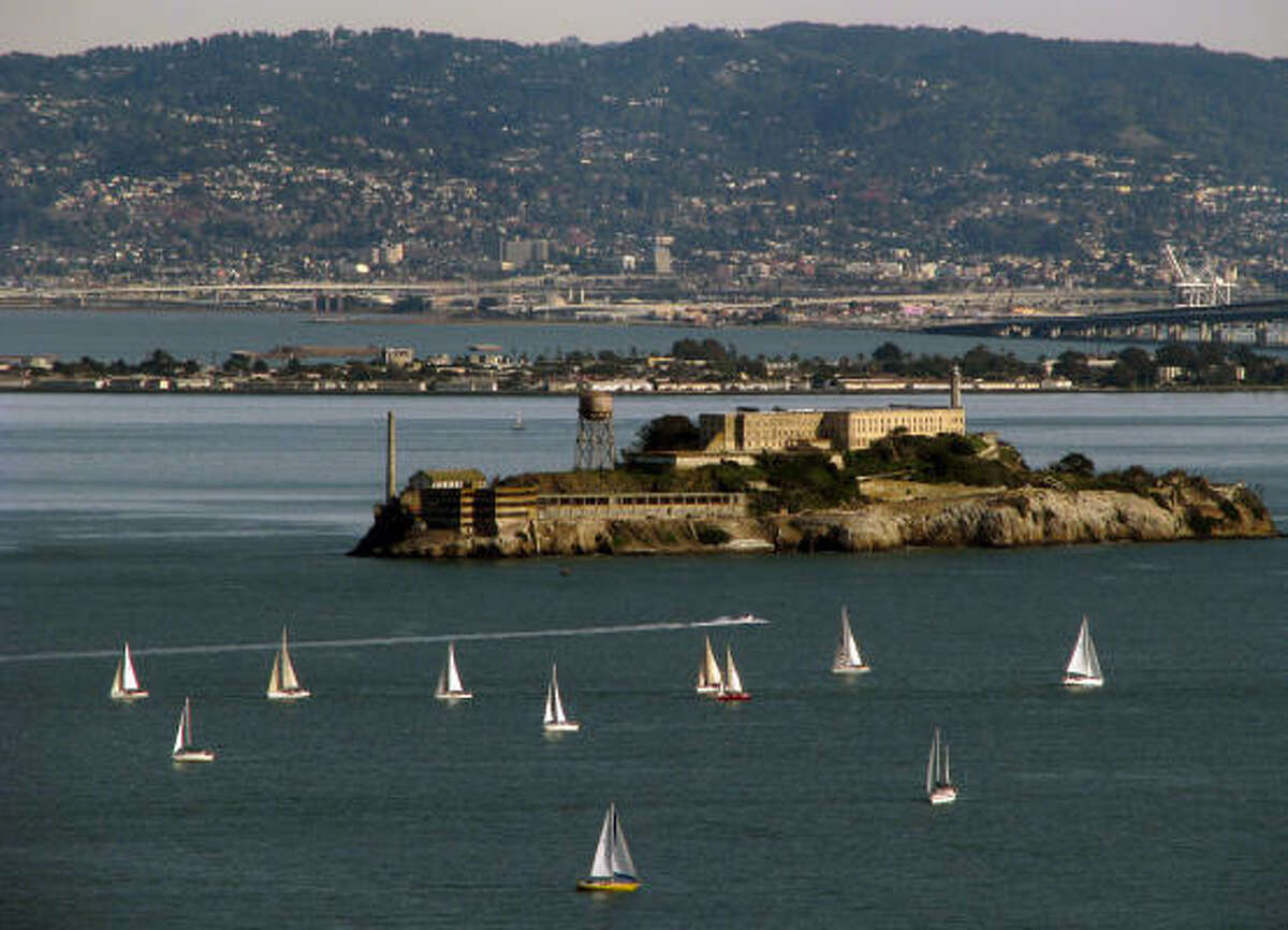 Alcatraz became a federal penitentiary in 1934, but today the island in San Francisco Bay is popular with tourists. Oakland and Berkeley can be seen in the distance.