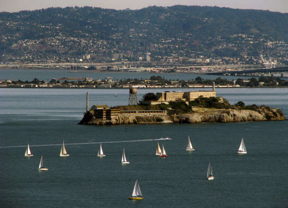 Alcatraz became a federal penitentiary in 1934, but today the island in San Francisco Bay is popular with tourists. Oakland and Berkeley can be seen in the distance. Photo: CHRISTOPHER REYNOLDS, LOS ANGELES TIMES