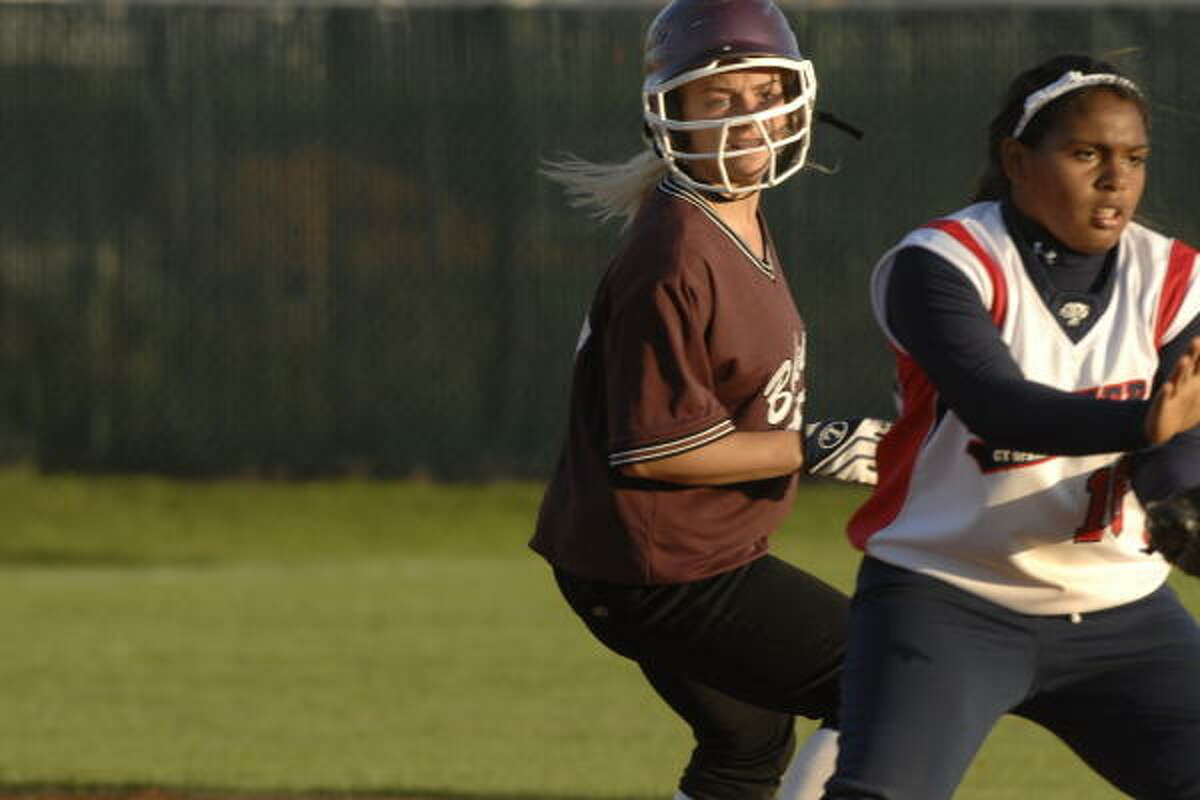 Cy Springs 5, Cy-Fair 3: Cy- Fair's Patti Bradshaw , left, reaches second base before Cy Springs' Kayla Holland can make a tag.