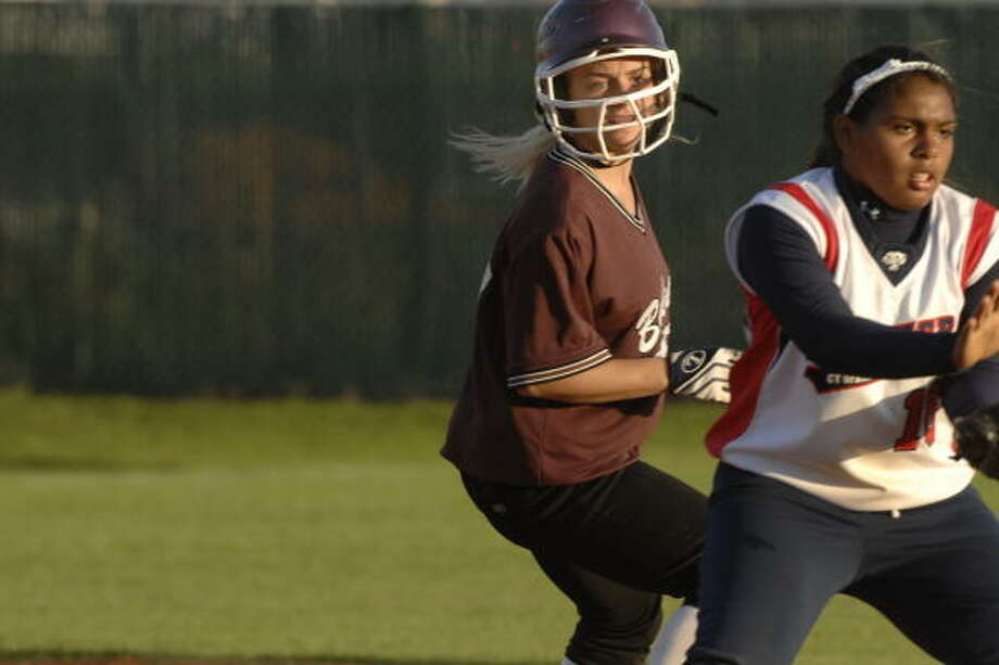 Cy Springs 5, Cy-Fair 3: Cy- Fair's Patti Bradshaw , left, reaches second base before Cy Springs' Kayla Holland can make a tag. Photo: Eddy Matchette, FOR THE CHRONICLE