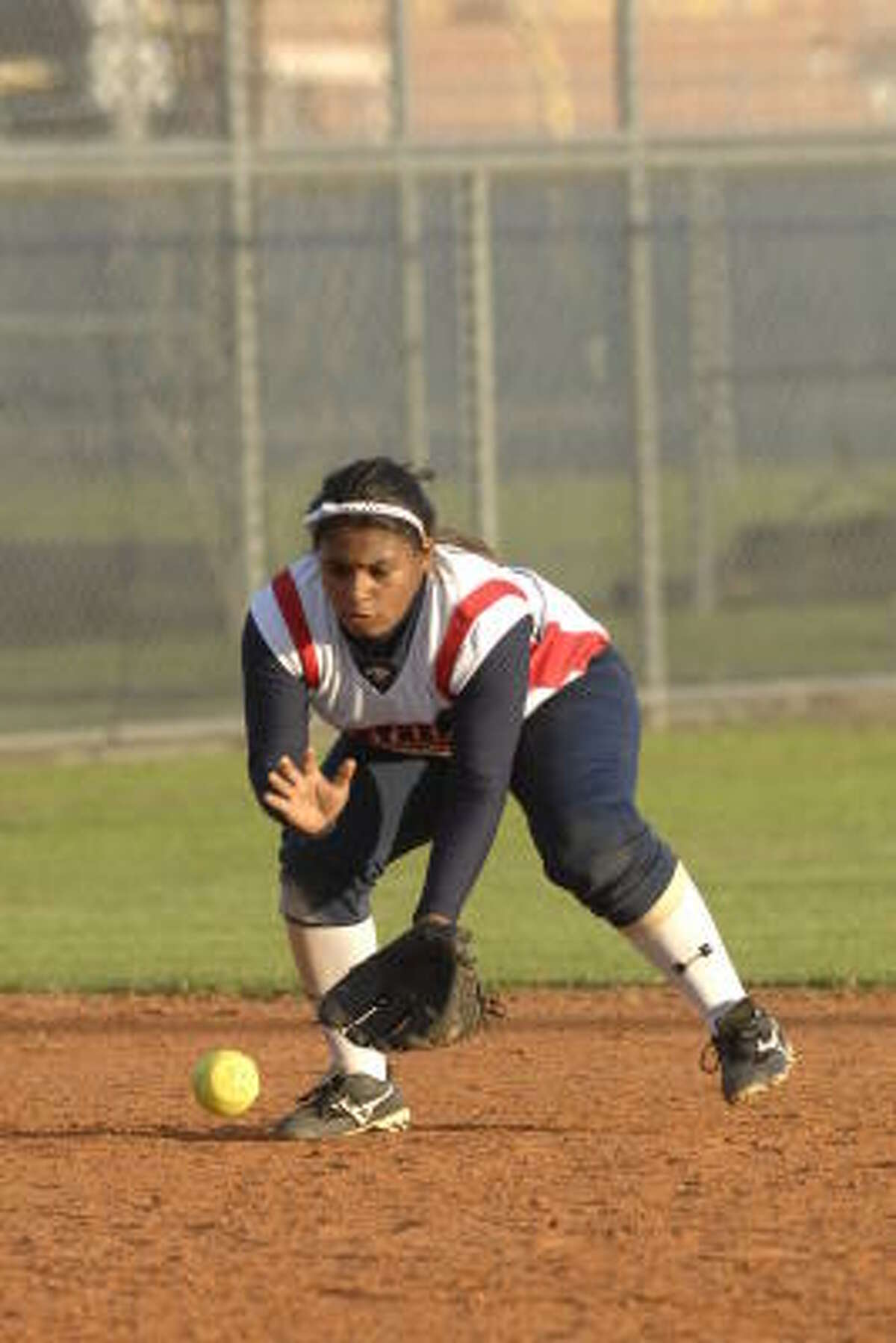 Cy Spring's shortstop Kayla Holland draws a bead on a ground ball.