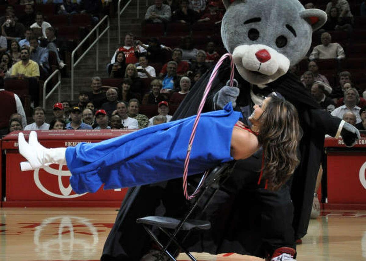 April 7, Magic at Rockets. Clutch perform a magic trick on a willing Power Dancer.