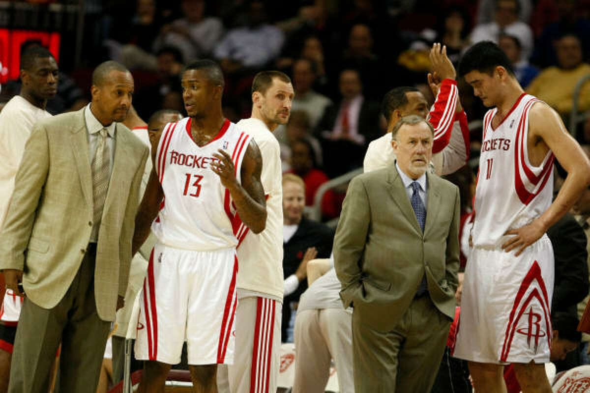 Rockets players talk things over during a break in the action.