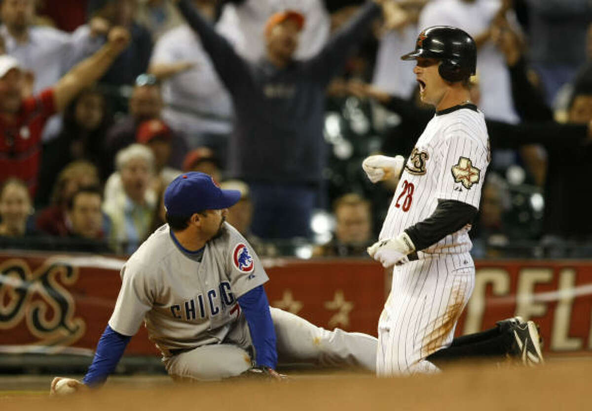Astros pinch-runner Jeff Keppinger (right) shows his frustration after being forced out by Chicago's Aaron Miles on a close play at third base in the ninth inning.