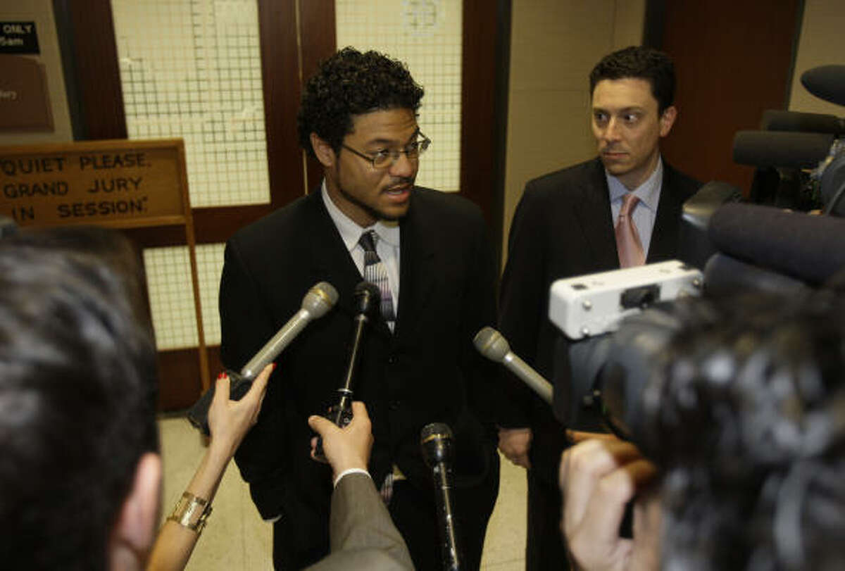"""Shooting victim Robert Tolan, center, speaks to the media after appearing before a Harris County grand jury in 2009. """"My family and I have been trying to seek justice,"""" Tolan said."""