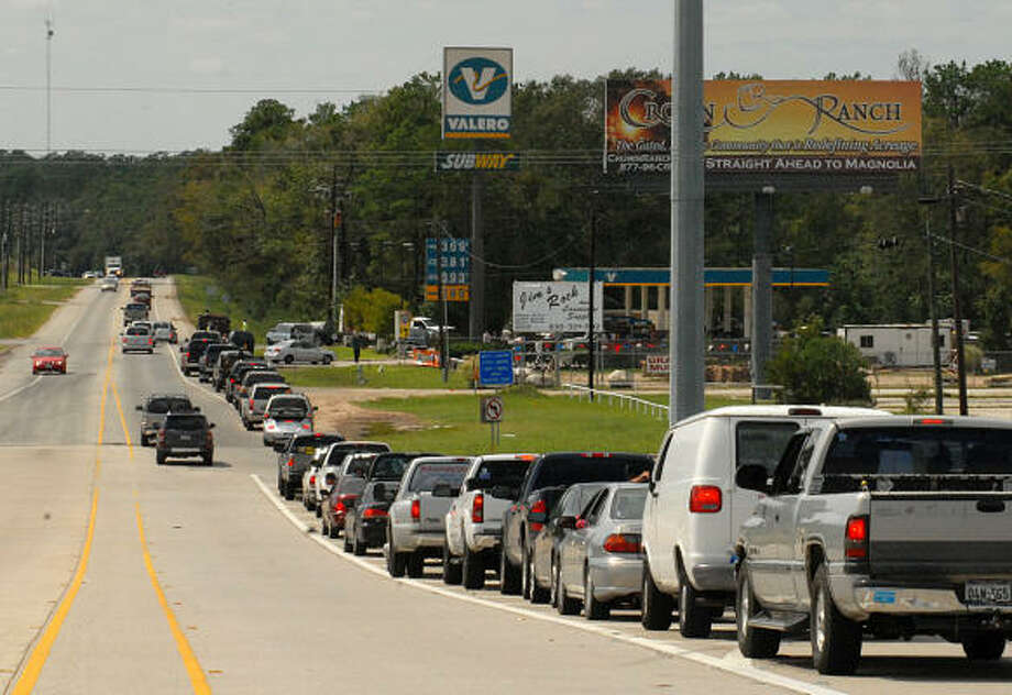 Cars line up to get gas at the Valero station on FM 1488 and I-45 South. At times the line stretched over the I-45 bridge. Photo: David Hopper, For The Chronicle