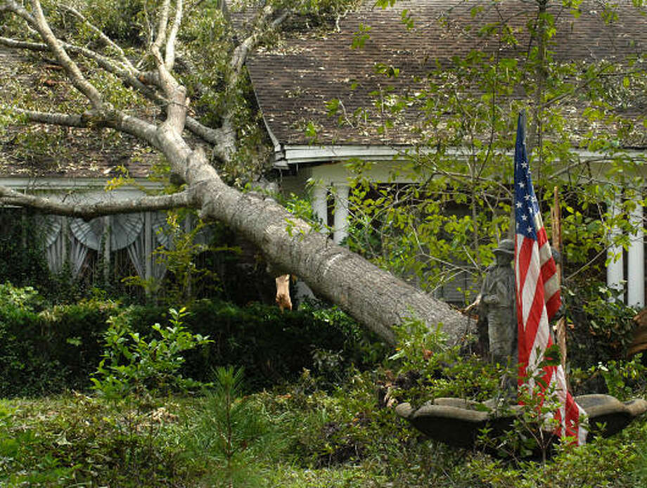 An American flag still waves at a house on Shady Oaks Dr. in North Conroe. Photo: David Hopper, For The Chronicle