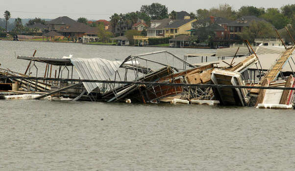 April Plaza Marina, 17742 Hwy 105 Wes, on Lake Conroe, suffered significant damage when a boat dock flipped over and landed on top of another boat dock at the Marina. Photo: David Hopper, For The Chronicle