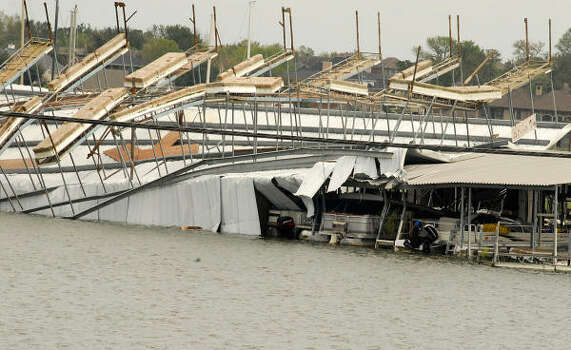 April Plaza Marina, 17742 105 West, on Lake Conroe, suffered significant damage when the wind caused a boat dock to flip up and on top of another boat dock at the marina. Photo: David Hopper, For The Chronicle
