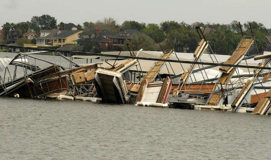 April Plaza Marina, 17742 Hwy 105 West on Lake Conroe, was hard hit by Hurricane Ike. Part of a boat dock was turned upside down and landed on another boat dock. Photo: David Hopper, For The Chronicle