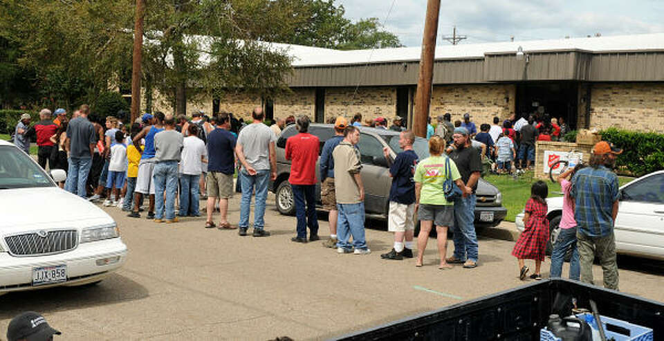 Hungry storm victims line up for a meal at the Montgomery County Salvation Army on Avenue E and 1st