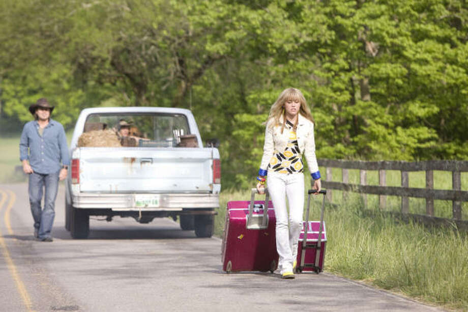 In Hannah Montana: The Movie, Miley  has become overwhelmed with her alter-ego's popularity. Photo: Sam Emerson, Disney