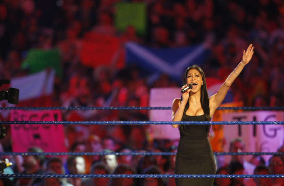 Nicole Scherzinger of the musical group the Pussycat Dolls sings to kick off the 25th anniversary of Wrestlemania held at Reliant Stadium. Photo: Julio Cortez, Chronicle