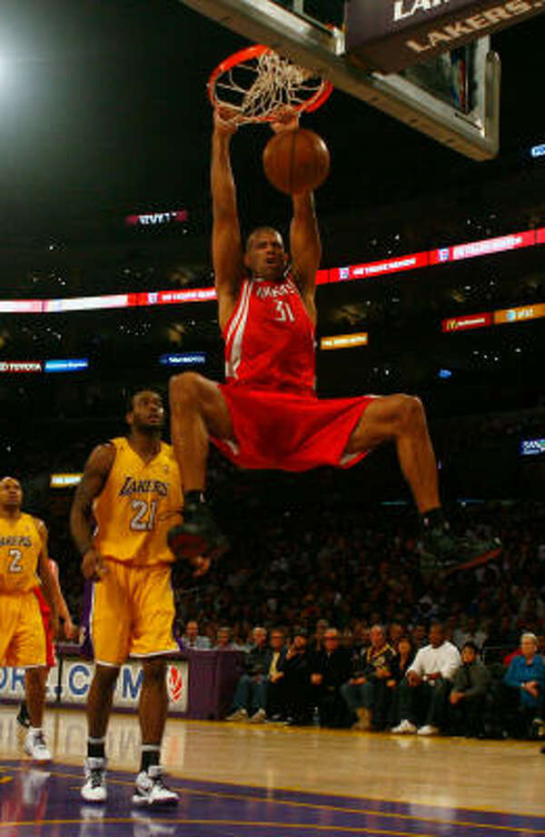 Rockets forward Shane Battier dunks in front of Lakers forward Josh Powell. Photo: Jeff Gross, Getty Images