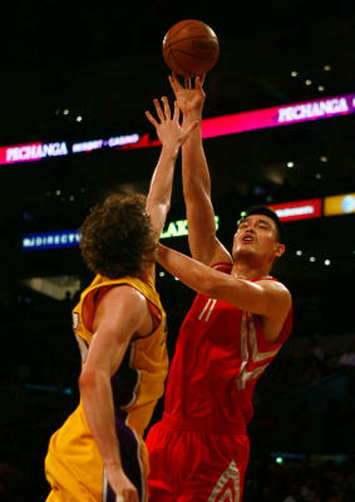 Rockets center Yao Ming shoots over Lakers forward Pau Gasol.