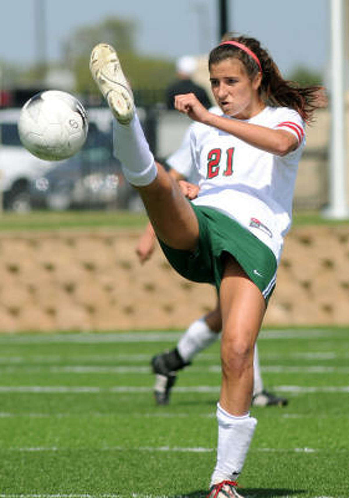 The Woodlands junior midfielder Kylie Cook makes a pass against Cy-Creek.