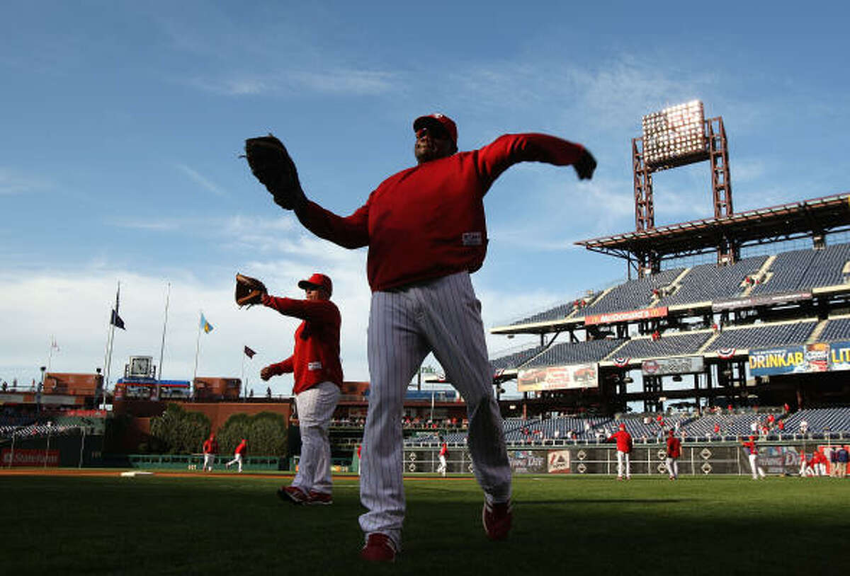 Ryan Howard of the World Series champion Philadelphia Phillies warms up before opening night against the Braves.