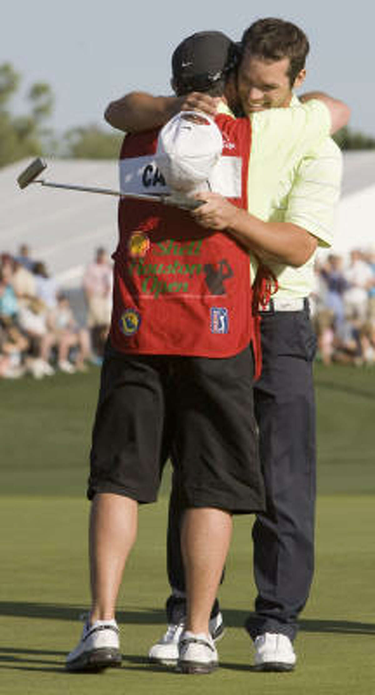 Paul Casey embraces his caddy Craig Connelly after winning the Shell Houston Open.