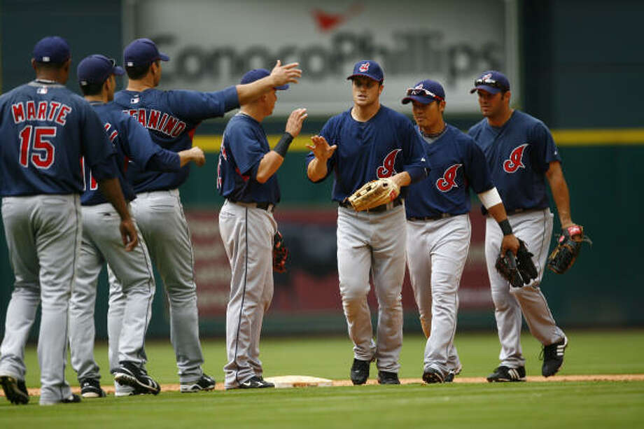 The Cleveland Indians celebrate their 4-3 victory over the Houston Astros. Photo: Michael Paulsen, Chronicle