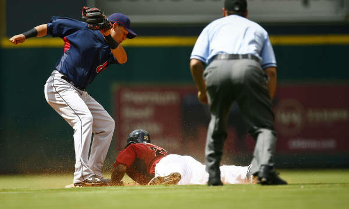 Astros outfielder Michael Bourn slides safely into second on a stolen base as Indians shortstop Asdrubal Cabrera tries to make a tag.
