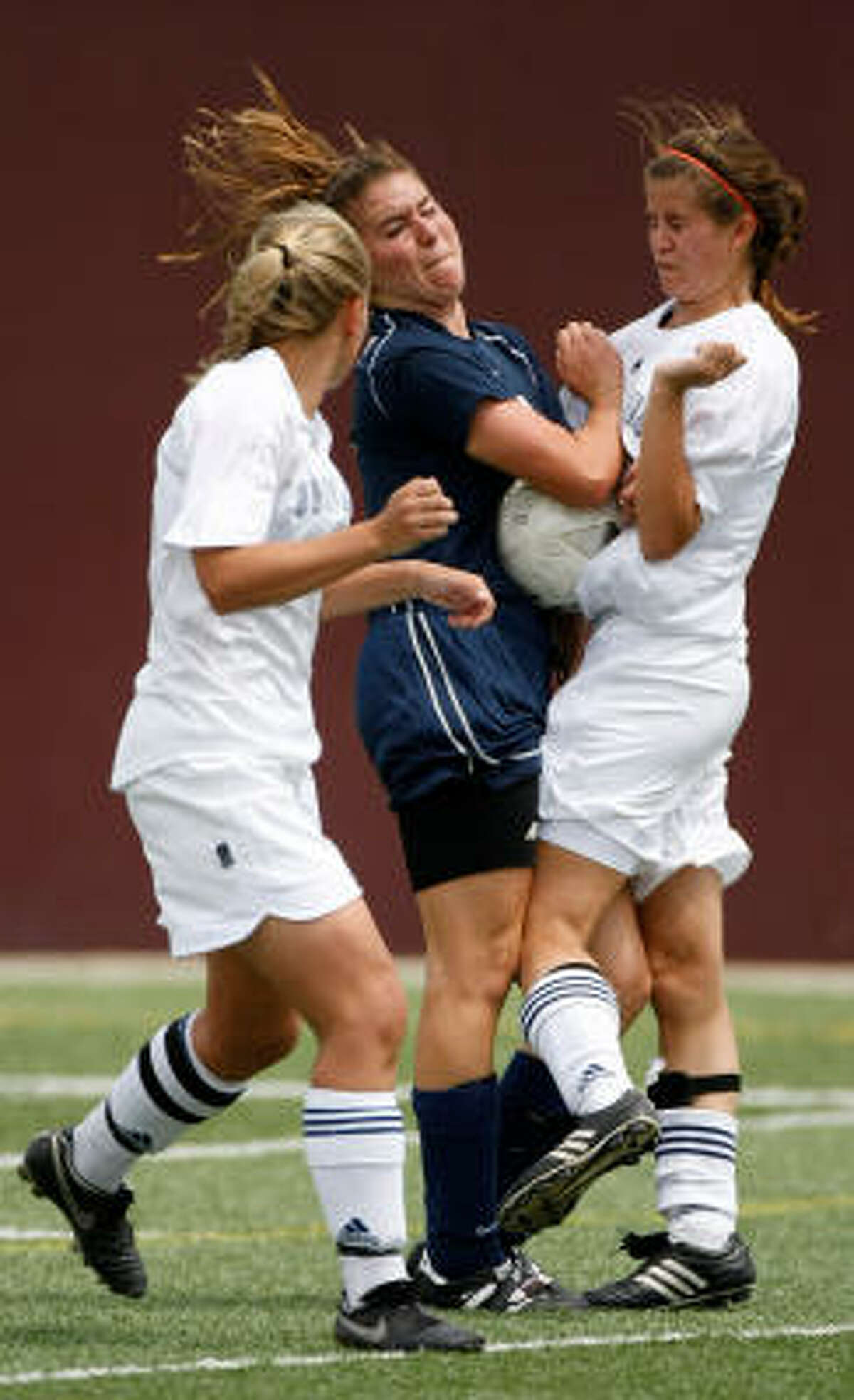 Clear Lake High School's Alyssa Van Baalen is squeezed by two Seven Lakes players.
