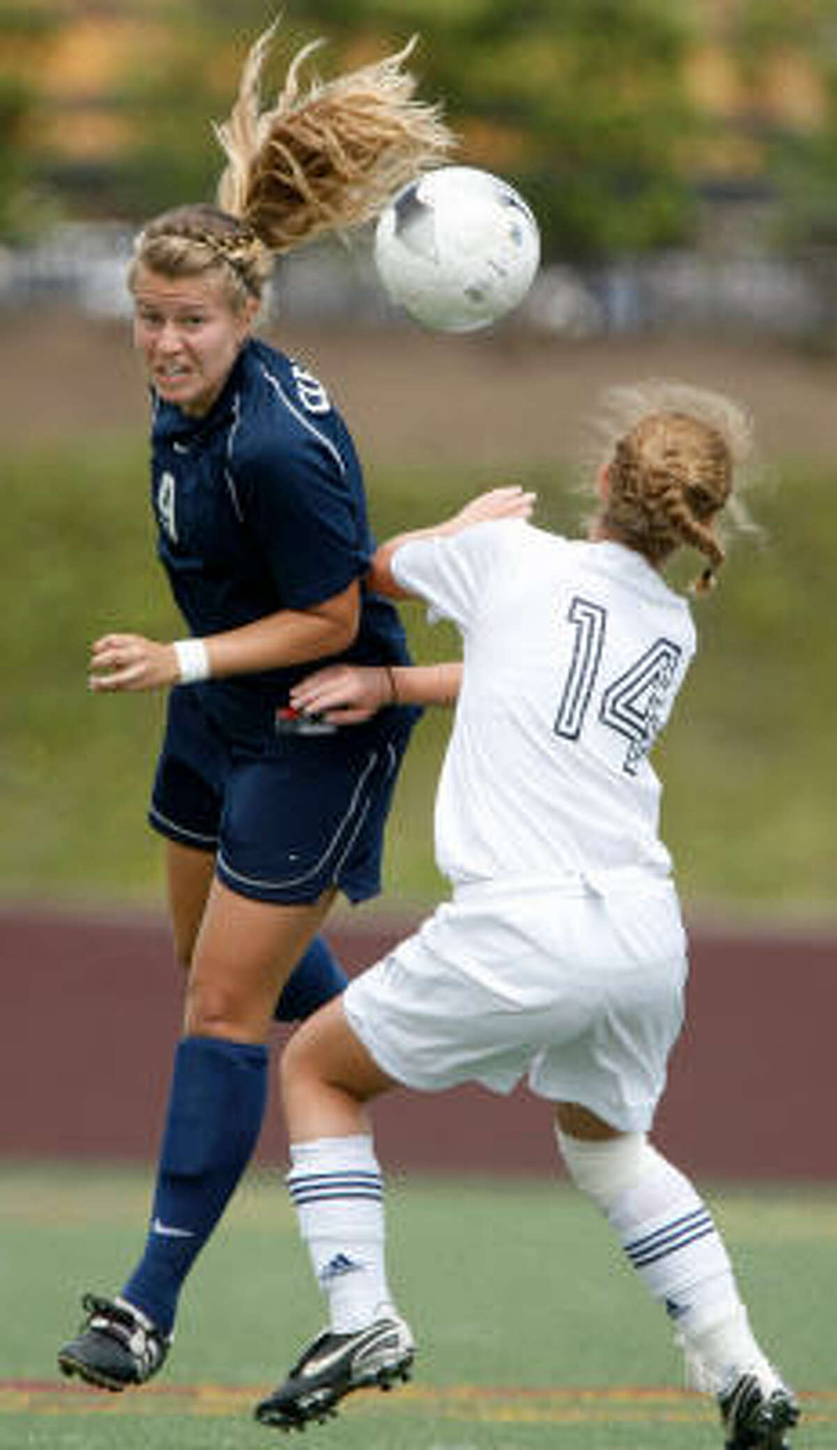 Clear Lake's Ana Pontes, left, wins a header against Seven Lakes' Carol Bentley.