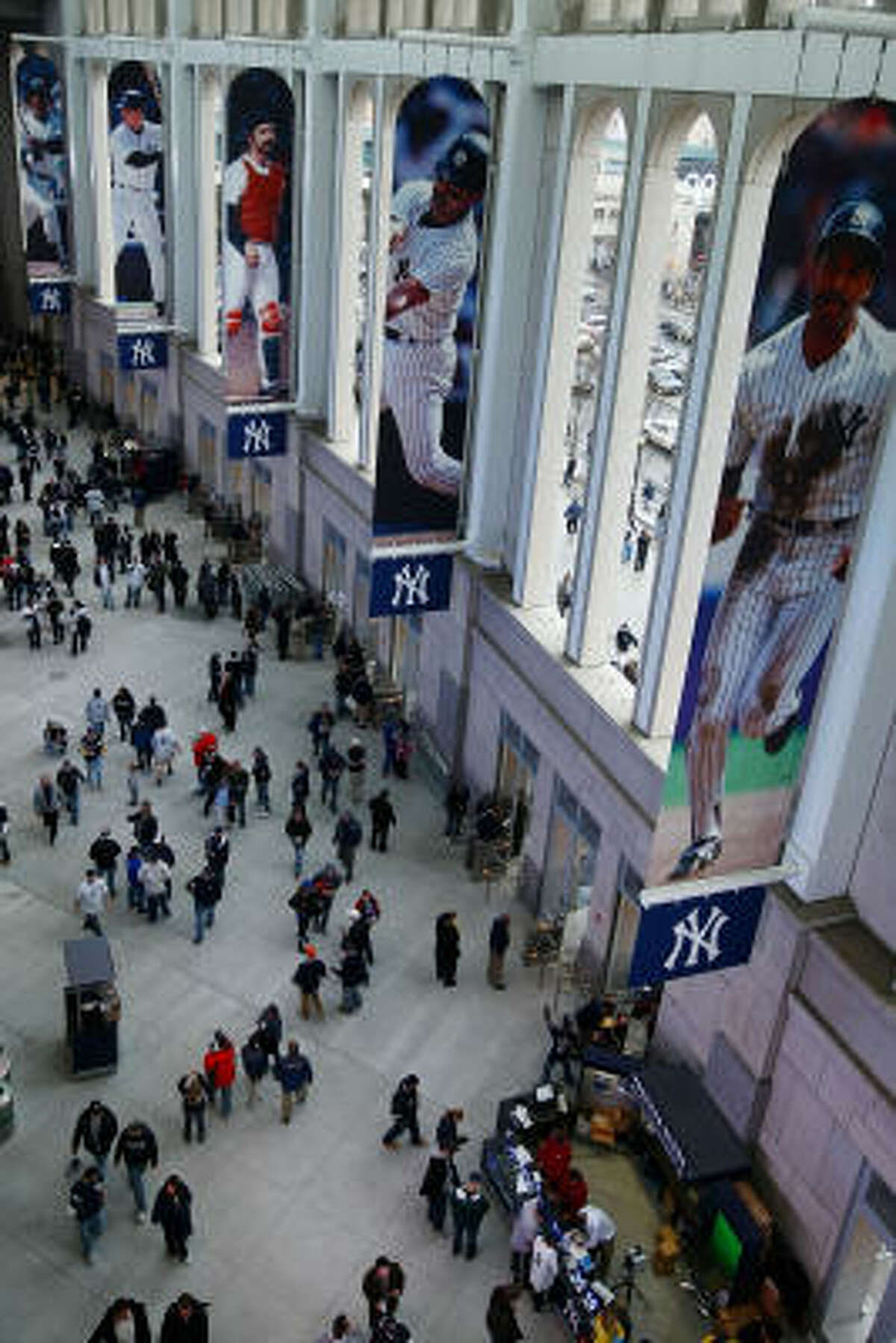 NEW YORK - APRIL 03: Fans enjoy the new Yankee stadium concourse area prior to the start of the game between the New York Yankees and the Chicago Cubs on April 3, 2009 in the Bronx borough of New York City. The exhibition game is the first game to be played at the new Yankee Stadium.