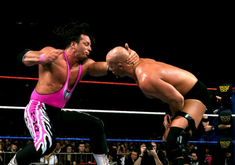 "Bret ""Hit Man"" Hart, left, beat Stone Cold Steve Austin in a classic submission match during WrestleMania 13 in 1997. Photo: AP"