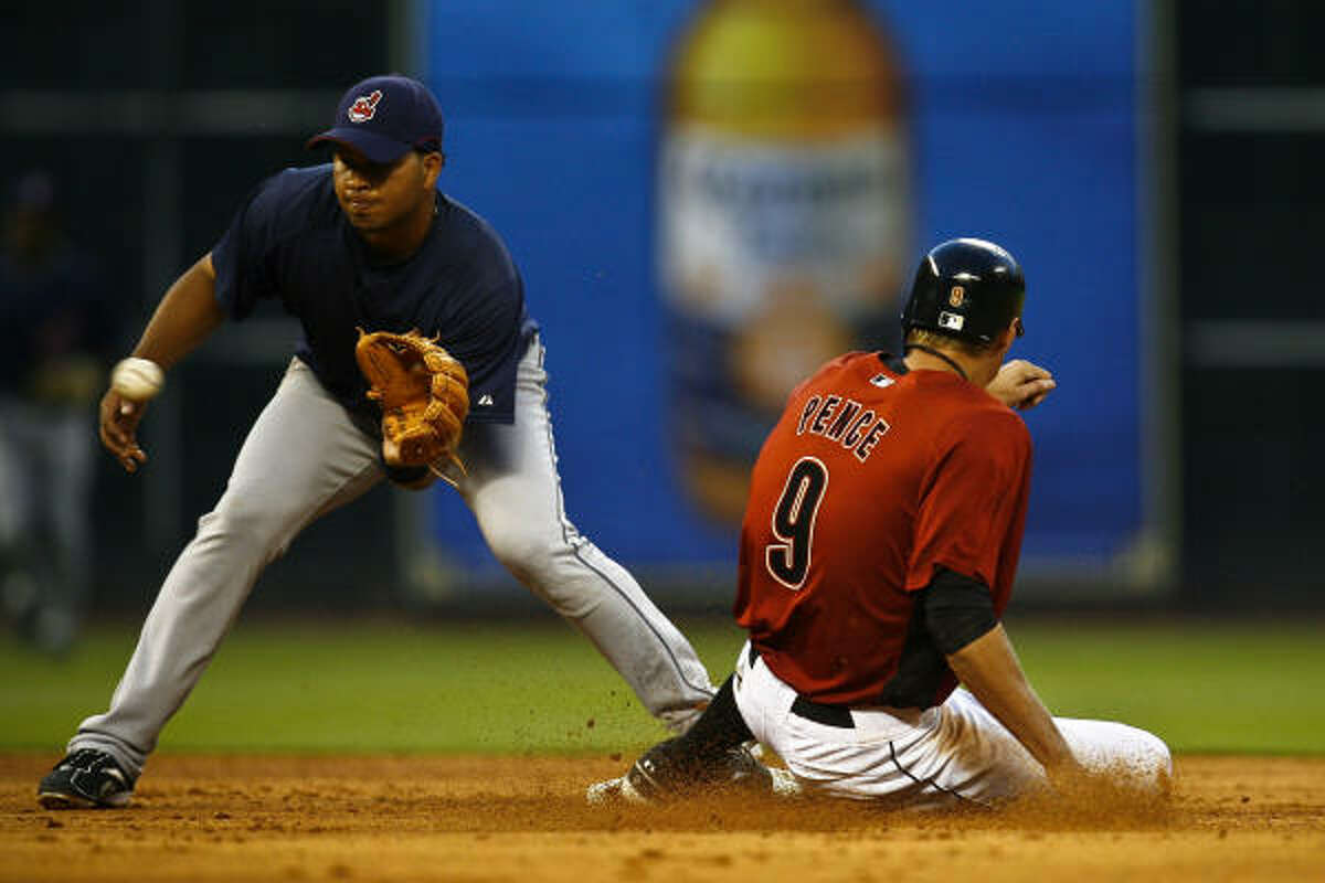 Astros outfielder Hunter Pence slides safely into second base as Indians shortstop Jhonny Peralta tries to make the tag.