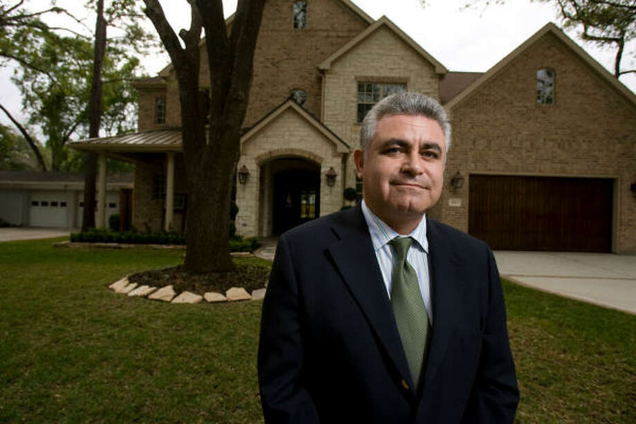 Amir Khosrowshahi, president of Protege Homes, stands in front of a custom home he is selling for a little over a million dollars. Photo: Nick De La Torre, Houston Chronicle