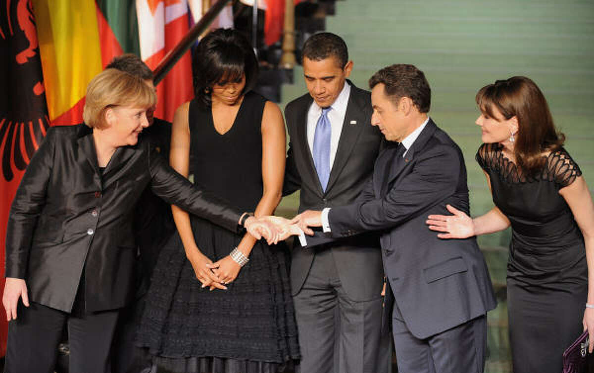 German Chancellor Angela Merkel, left, greets French President Nicolas Sarkozy as his wife, Carla Bruni-Sarkozy, President Obama and first lady Michelle Obama look on during the NATO summit in Baden-Baden, Germany, April 3.