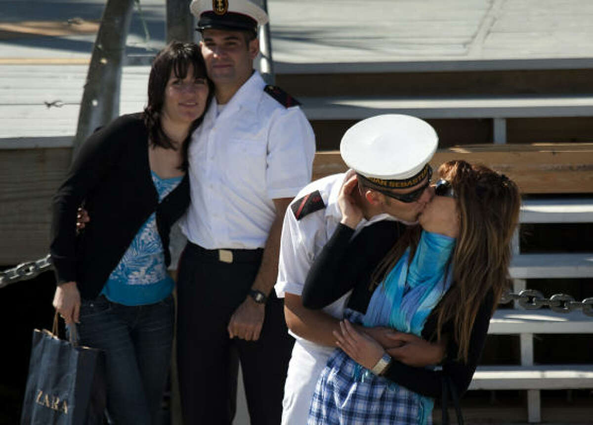 Crew members are greeted on the dock after the Spanish Navy Tall Ship Juan Sebastián de Elcano arrives Friday in Galveston.