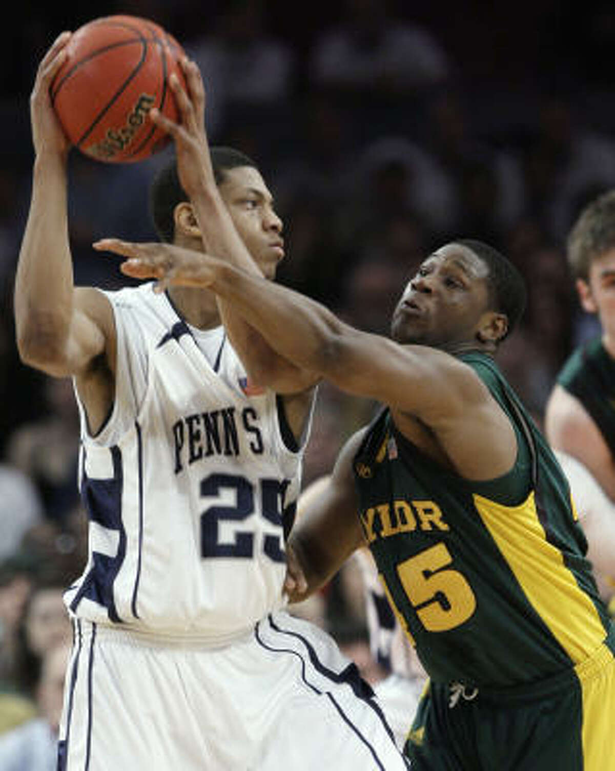 Baylor's Darren Kent, right, defends Penn State's Jeff Brooks during the first half of Thursday's NIT championship game in New York. Penn State won 69-63.