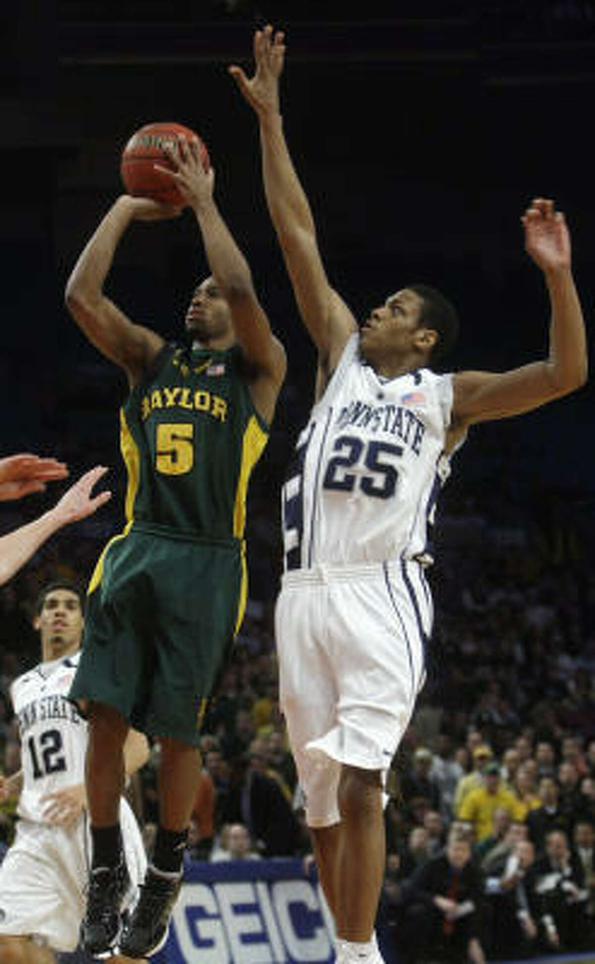 Baylor's Henry Dugat (5) drives past Penn State's Jeff Brooks (25) for a shot during the first half.