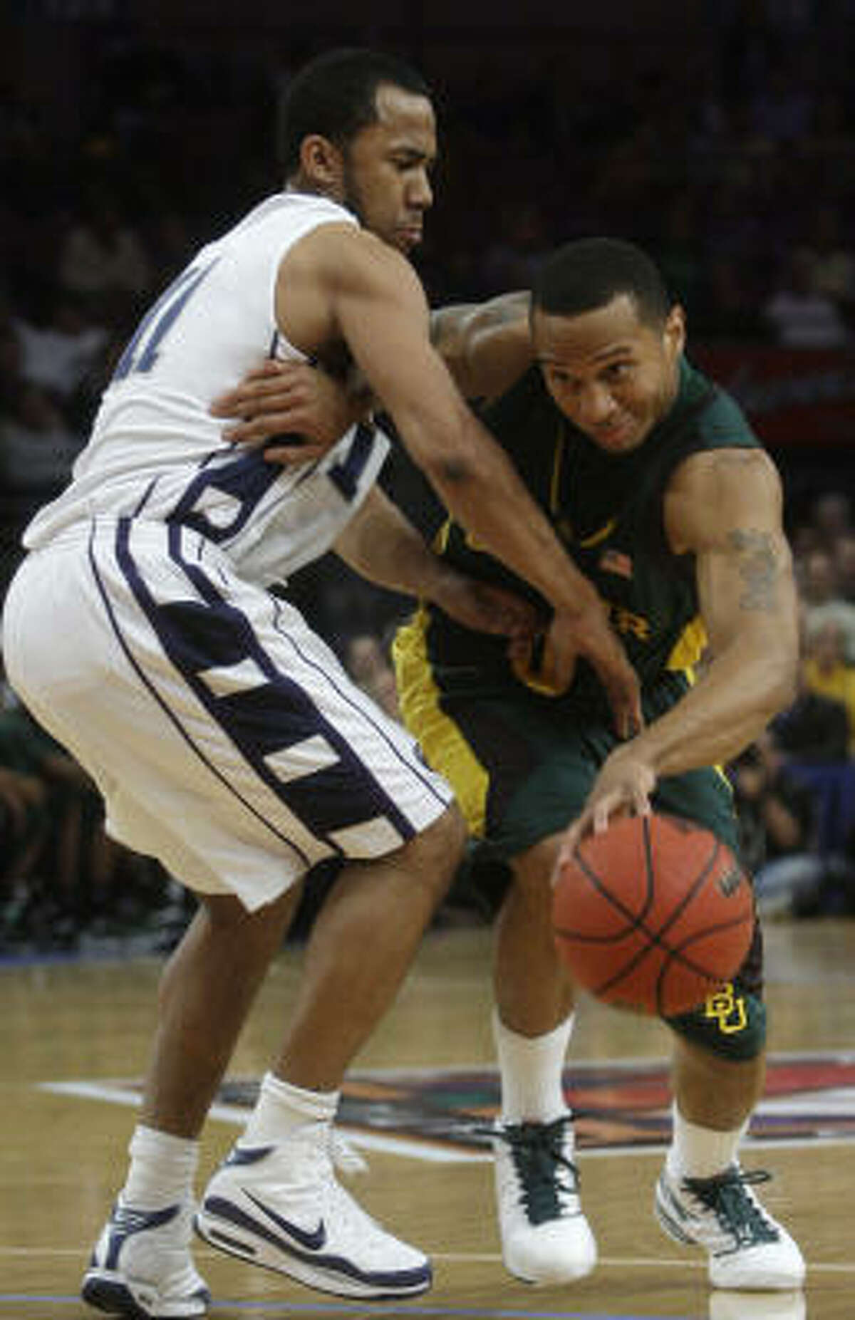 Baylor's Curtis Jerrells (right) drives past Penn State's Stanley Pringle during the first half.
