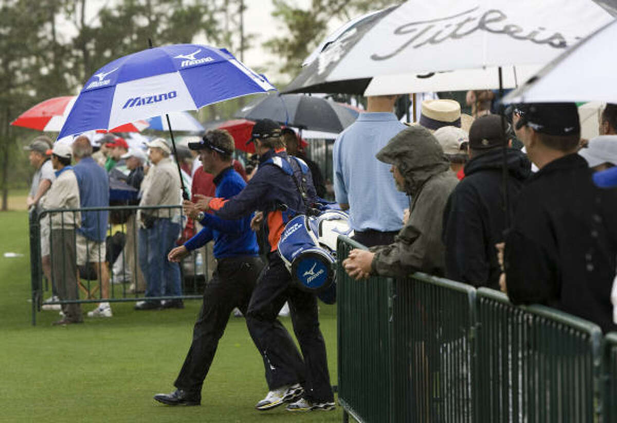 Luke Donald walks toward the driving range before the first round Thursday. The start was delayed for more than two hours because of rain.