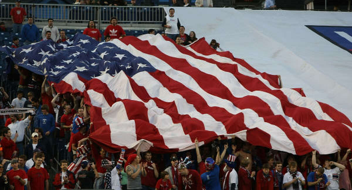 Fans unfurl a large U.S. flag at LP Field in Nashville.
