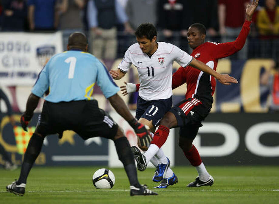 U.S. 3, Trinidad and Tobago 0Brian Ching of the United States moves towards goalkeeper Clayton Ince as Aklie Edwards defends at LP Field in Nashville, Tenn. Photo: Jonathan Daniel, Getty Images