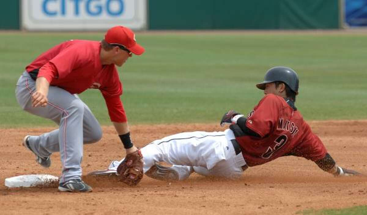 Cincinnati Reds second baseman Chris Valaika, left, applies the tag as Houston Astros' Kazuo Matsui safely steals second during the third inning.