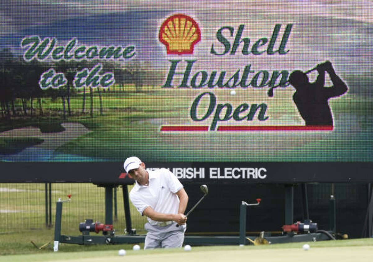 Sergio Garcia hits a chip shot onto the practice green during practice rounds for the Shell Houston Open.