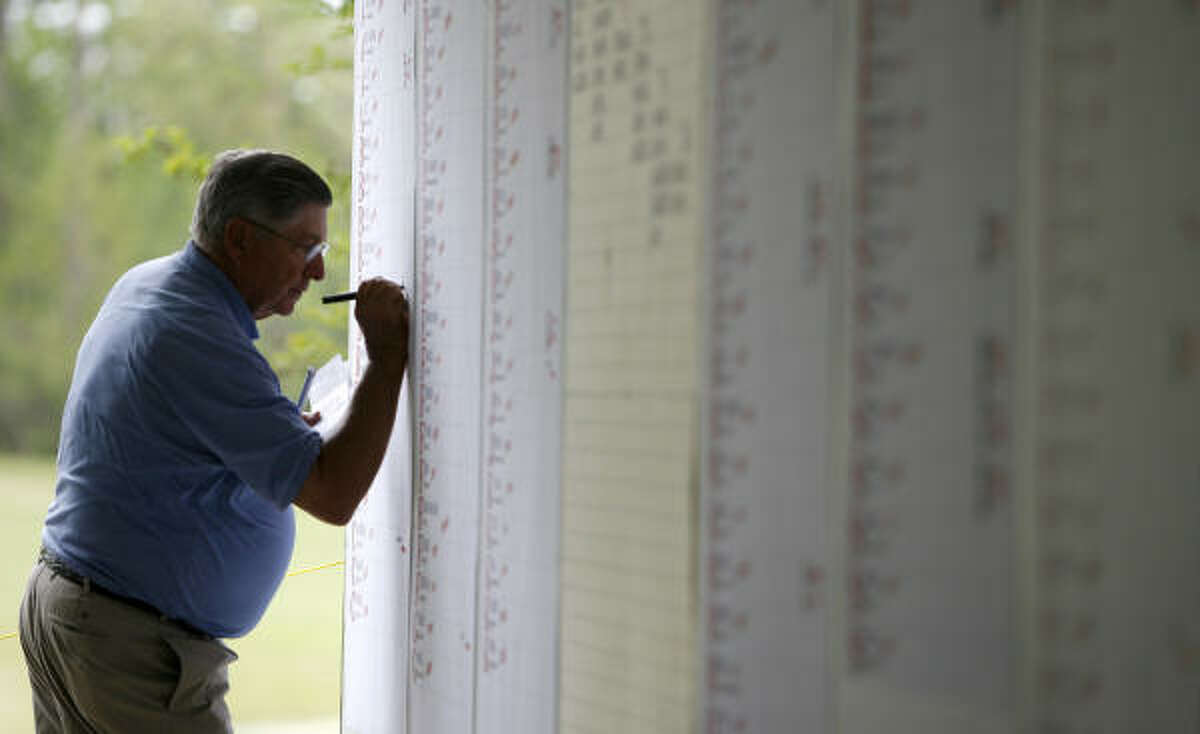 Ron Weber, (cq) media room scorekeeper for the Shell Houston Open, waits for scores during the Shell Houston Open Qualifying round.