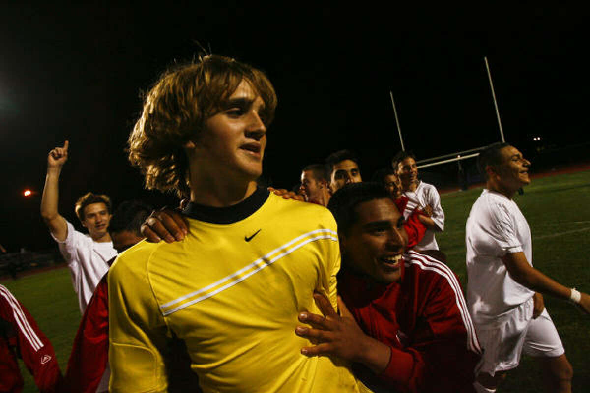 Katy goalkeeper John Huttenhoff is congratulated by teammates after leading his team to a victory.