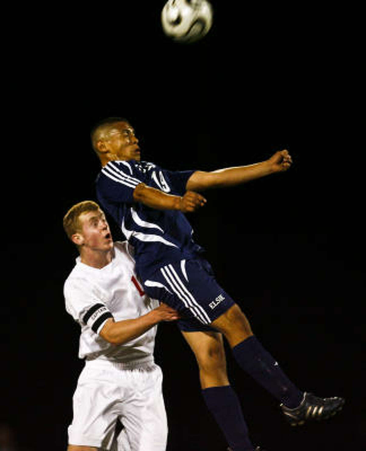 Christopher Shilling of Katy battles with Aurelio Vera of Elsik for a header.
