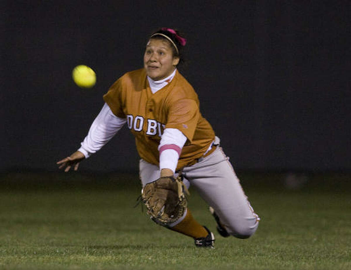 Dobie High School's Nicole Andrade misses a diving catch in the fifth inning.