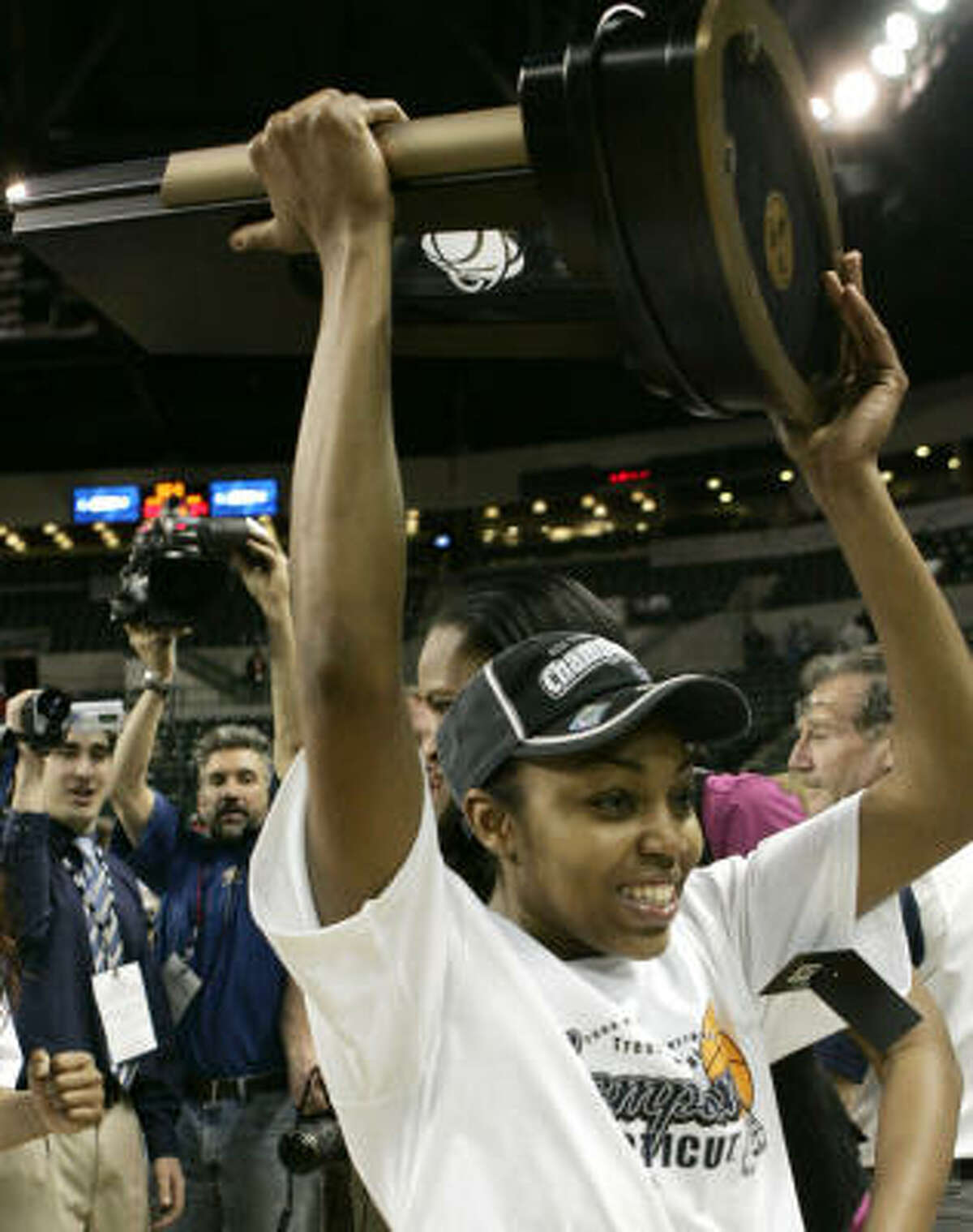 Trenton (N.J.) Region, Regional Finals: Connecticut 83, Arizona State 64 Connecticut's Renee Montgomery holds the regional champion's trophy after Connecticut beat Arizona State in an NCAA women's college basketball tournament regional final.